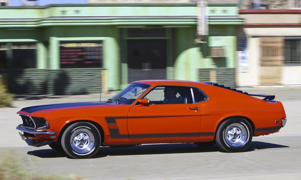 1969 Ford Mustang Boss 302 Side View In Motion Wallpaper